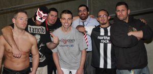Pac, El Generico, Colt Cabana, Matt Cross and the Pro Wrestling Collision crew of Kevin Hunsperger (front middle), Chris Hagstrom and Adam Testa.