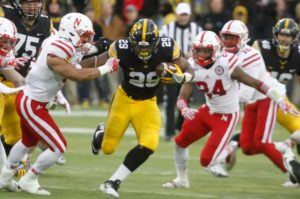 IOWA CITY, IOWA- SEPTEMBER 10: Running back LeShun Daniels #29 of the Iowa Hawkeyes runs up the field in front of linebacker Dedrick Young #5 and safety Aaron Williams #24 of the Nebraska Huskers during the second quarter, on November 25, 2016 at Kinnick Stadium in Iowa City, Iowa. Photo by Matthew Holst/Getty Images
